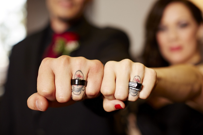 They got matching skull tattoos on their ring fingers.
