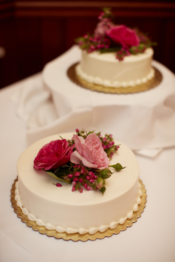 The cake's floral accents match the bride's bouquet