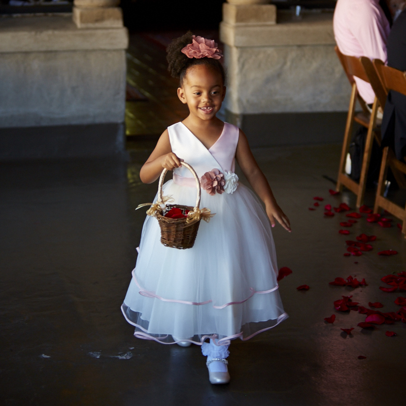 This flower girl had great focus, an even distribution of petals on her walk up and a big smile. A+