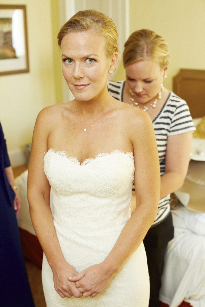 The bride gets in to her wedding dress
