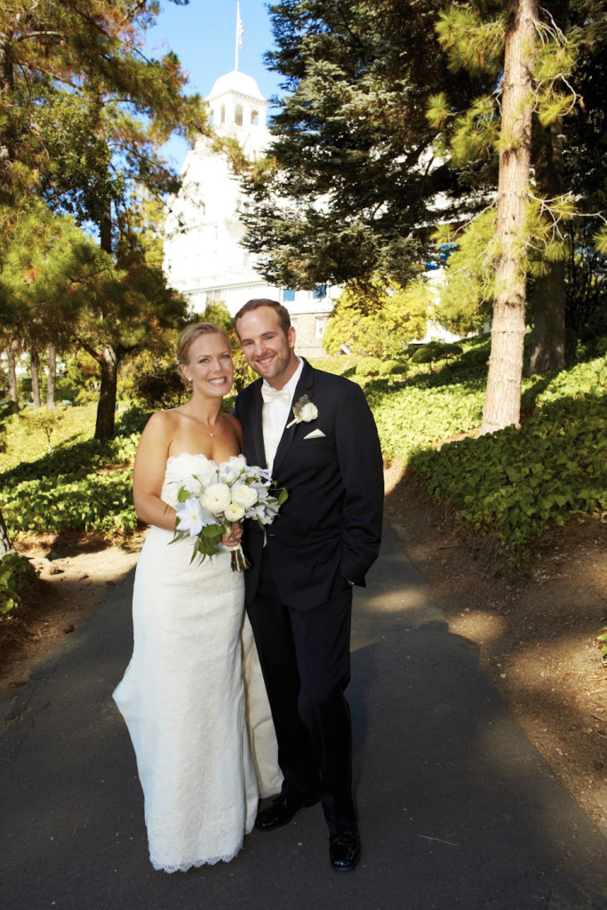 A portrait in front of the Claremont Hotel on their wedding day