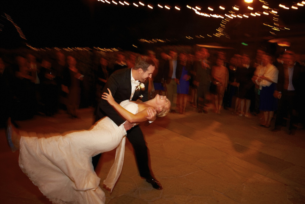 The bride is dipped on the dance floor