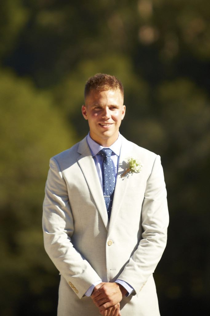 The groom sees his bride for the first time