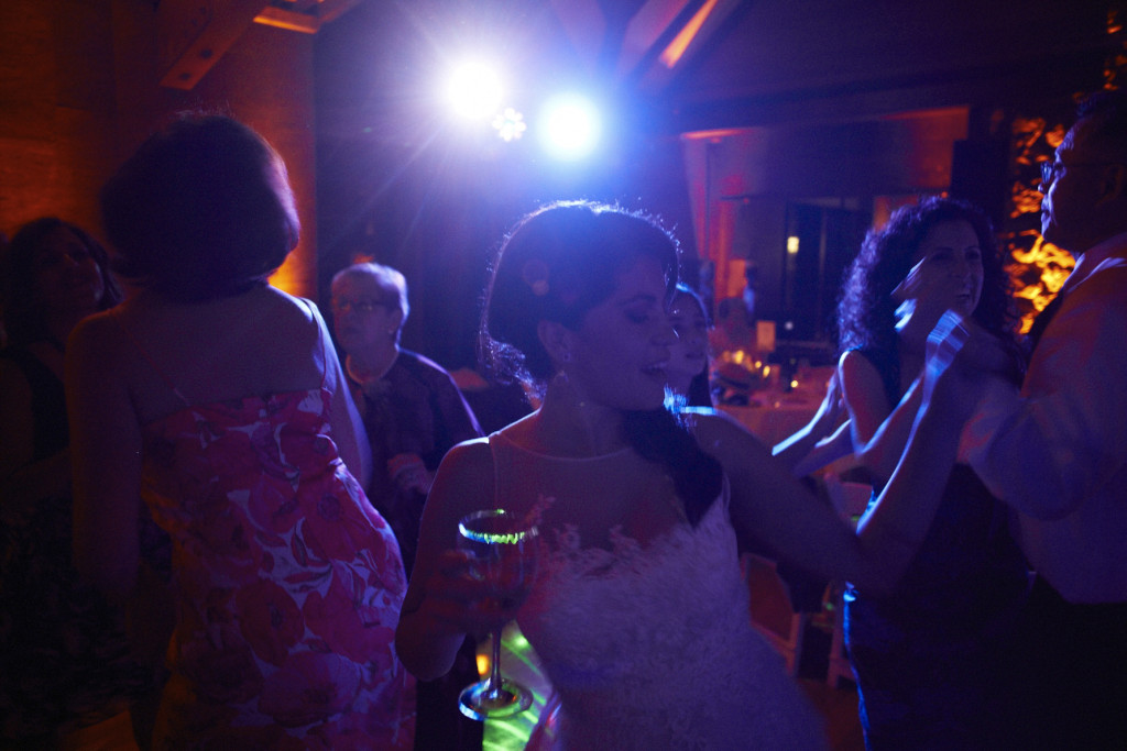 On the dance floor with her champagne glass