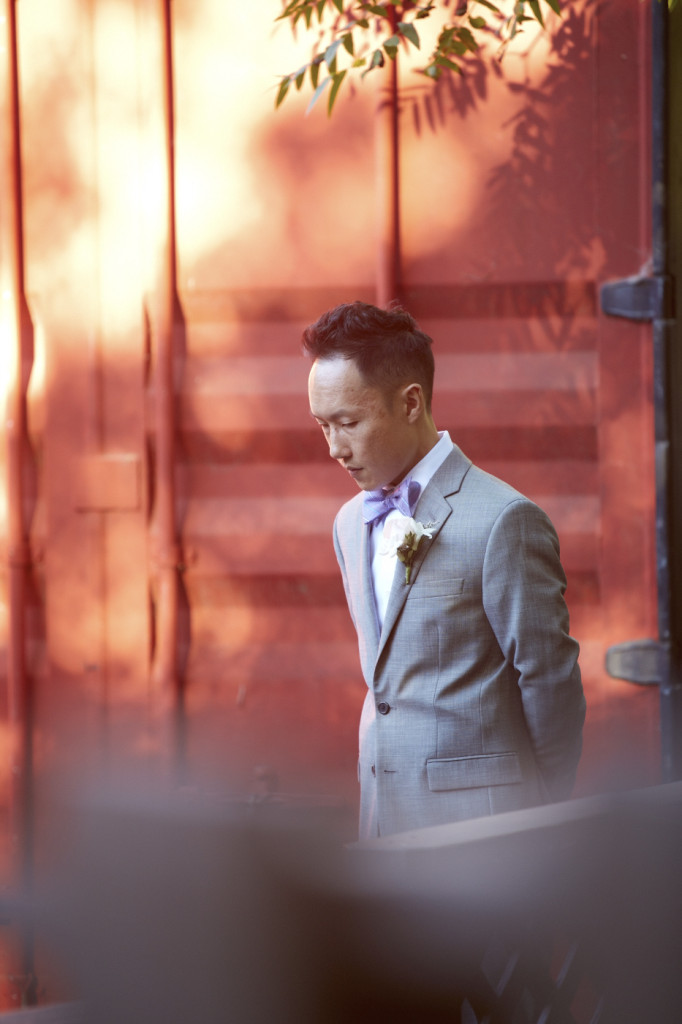 The groom takes a moment before the ceremony to collect himself.