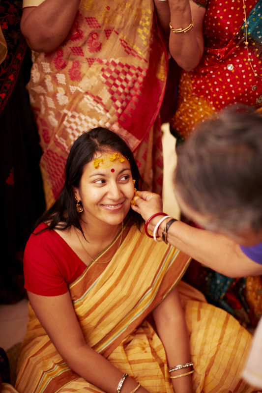 Everyone took turns applying some turmeric paste to the bride's face.