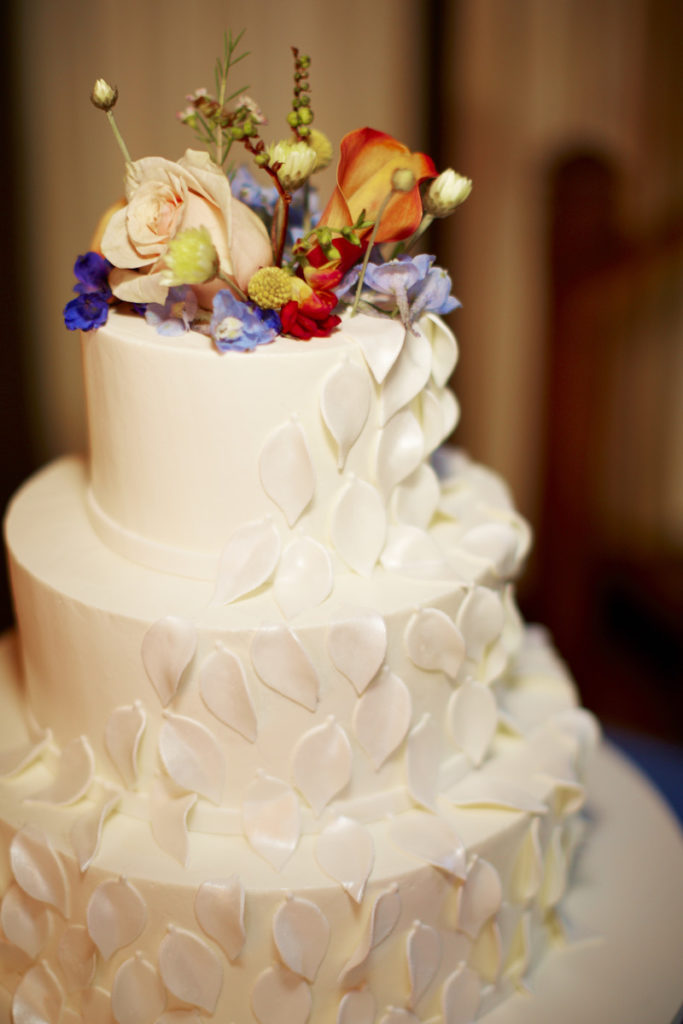 Wedding cake with floral accents that match the bride's bouquet.