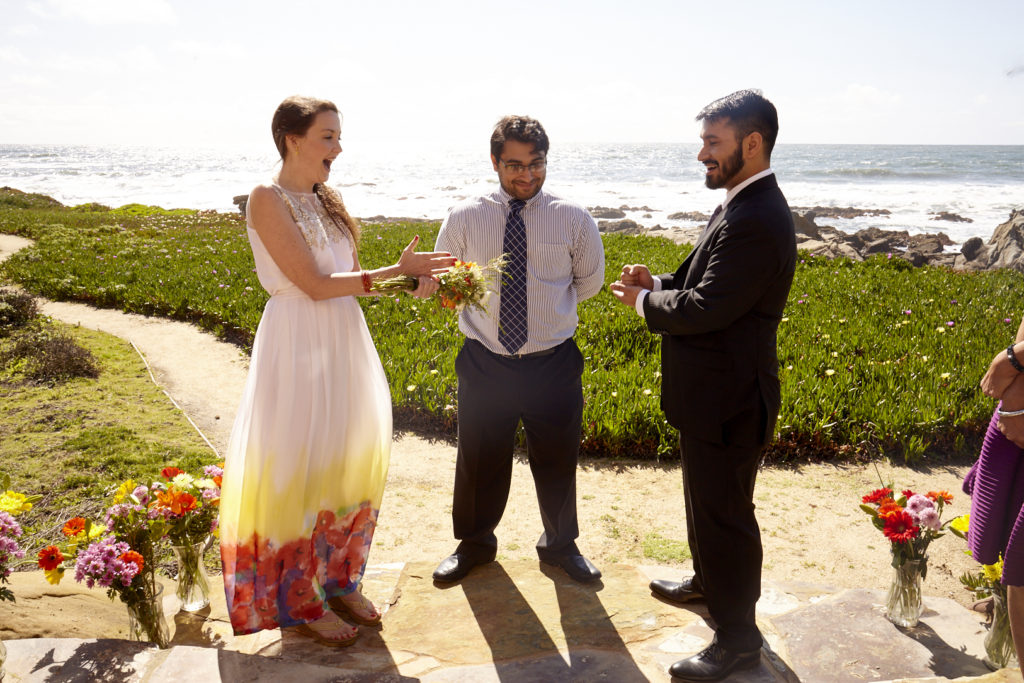 Rock, Paper, Scissors decides who reads their vows first.