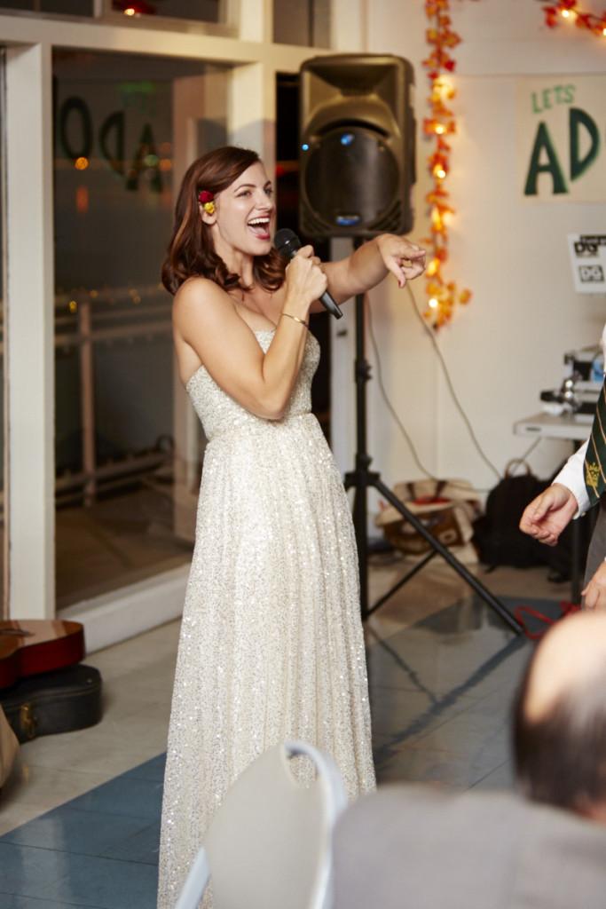 The bride serenades the groom