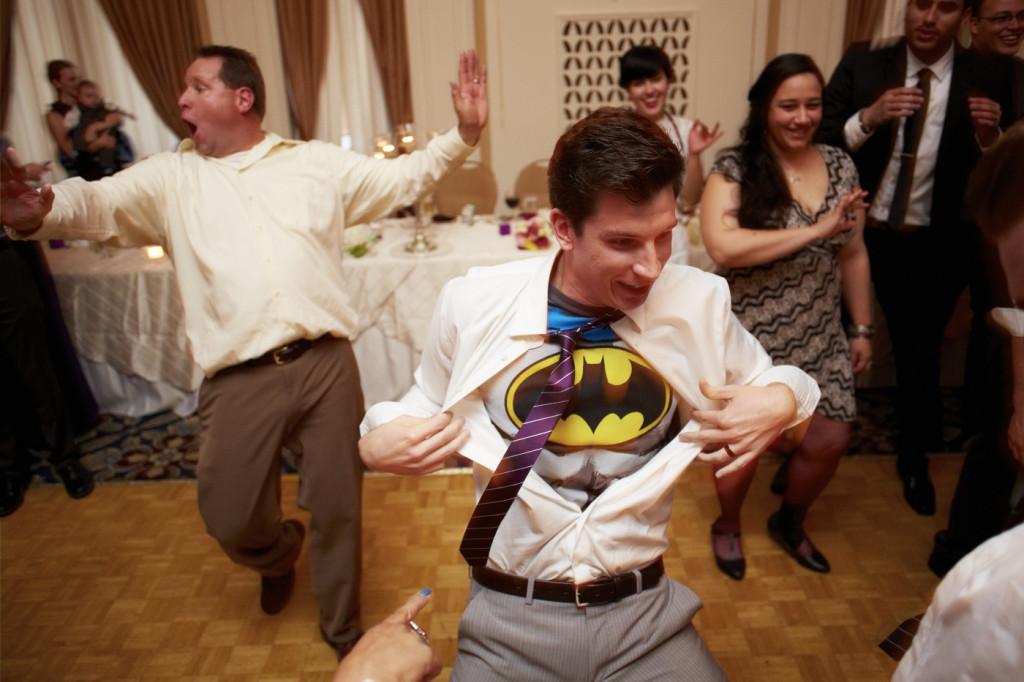 The groom reveals his secret identity.
