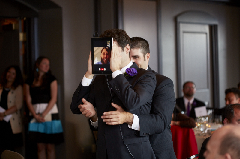 One Groomsman to hold the tablet, another to make the hand motions