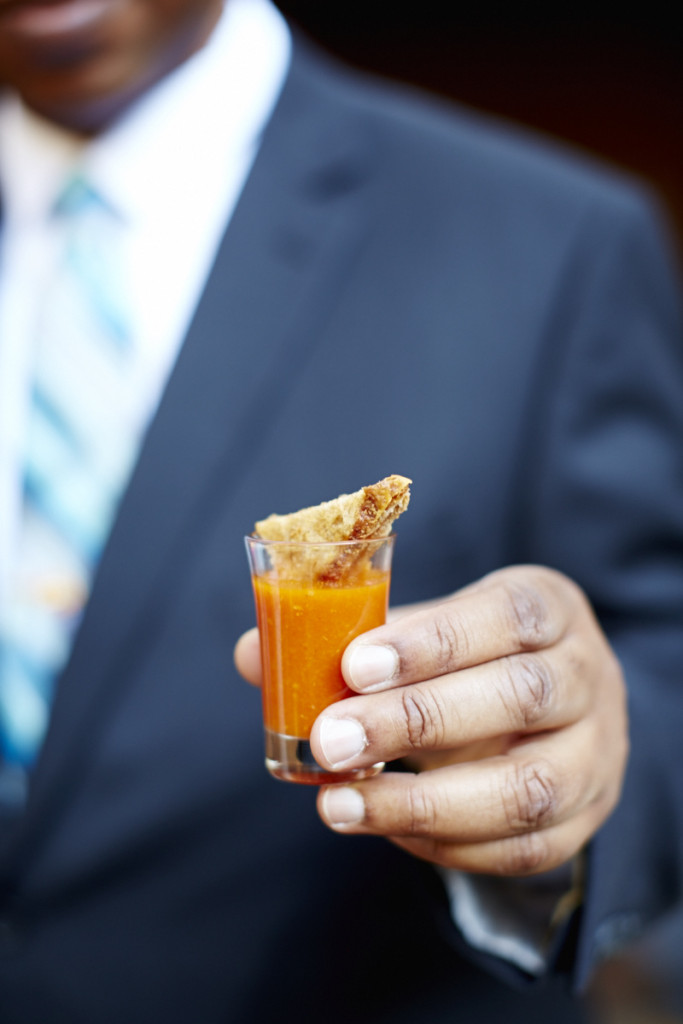 Grilled cheese sandwich bite with tomato soup shot.