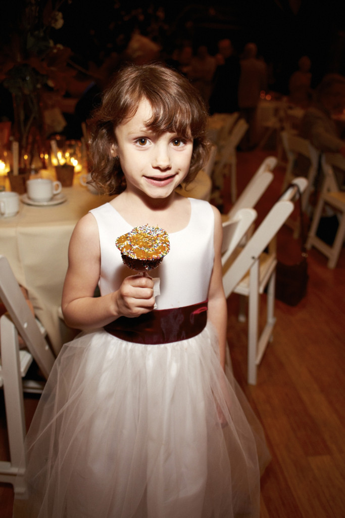 Flower girl with a candy apple
