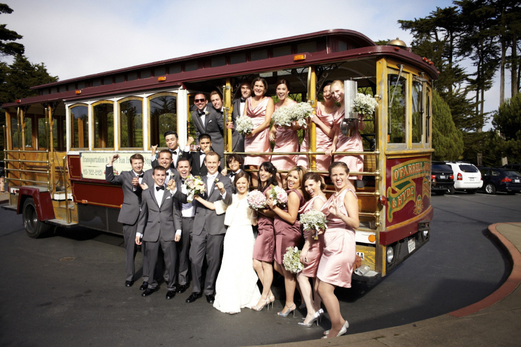 The wedding party in front of the trolley bus
