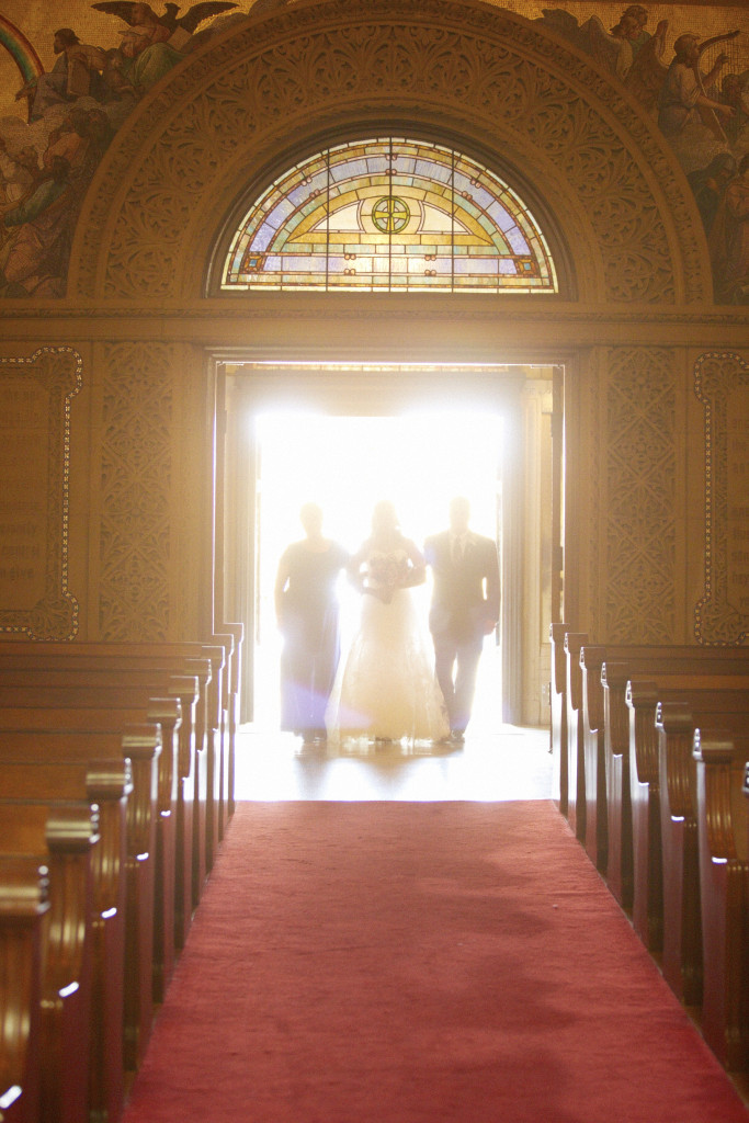 The bride enters with her parents