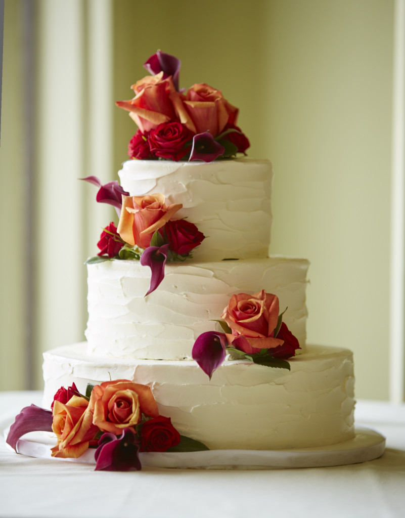 Cake with rose and lily accents