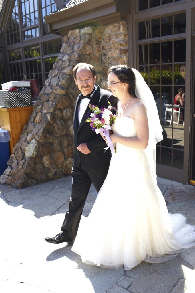 The father fo the bride escorts his daughter
