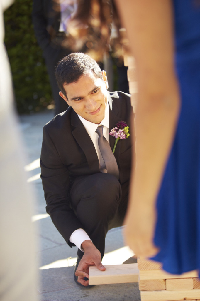 The groom starts a game of Jenga