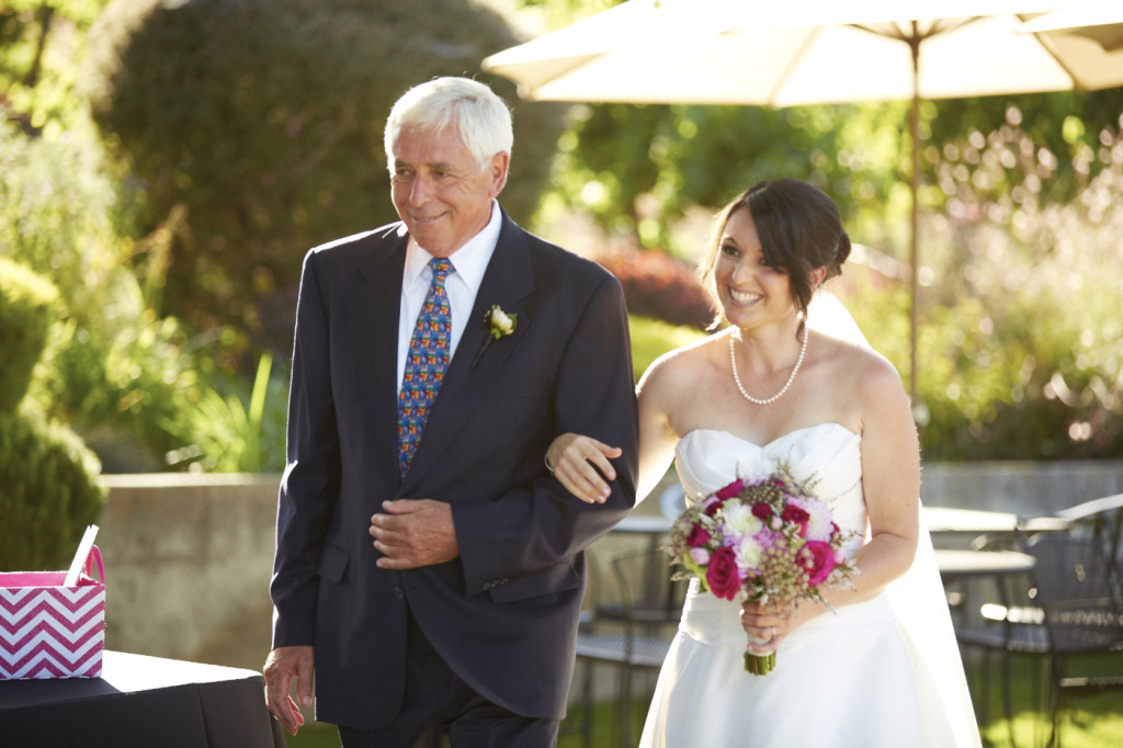 The father of the bride escorting her down the aisle